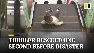 Toddler rescued from escalator one second before disaster