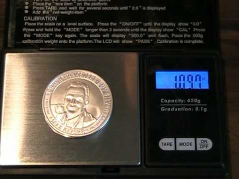 Weighing different silver coins and bullion