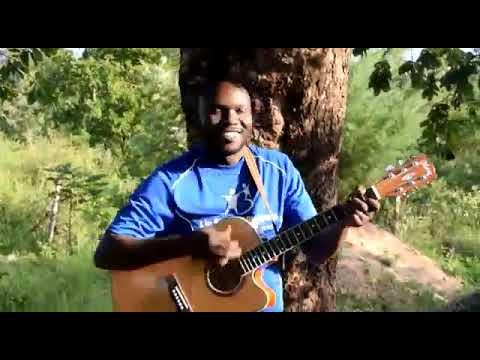Muti ini. At the cross.  Kamau karongo singing muti ini
