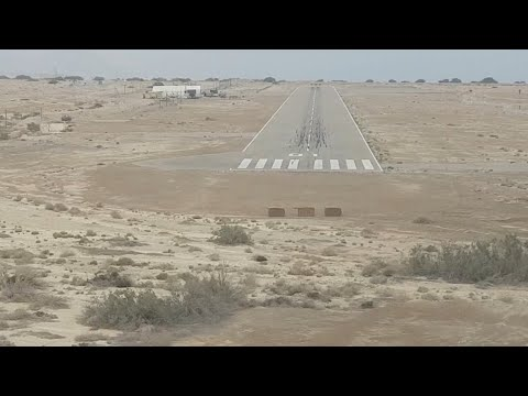 Jet aircraft landing in isolated airstrip