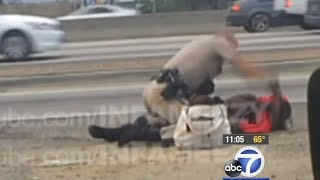 Cop Brutally Punches Woman On The Highway (Warning: Graphic Video)