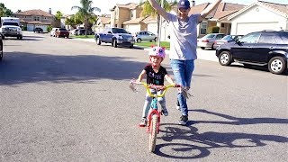 TEACHING HER HOW TO RIDE A BIKE!