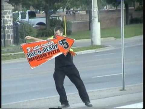 Little Caesars dancing Pizza Sign Guy.
