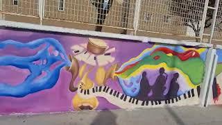 """Svelato il """"Muro del suono"""", 50 metri di colore su via Sant'Elia"""