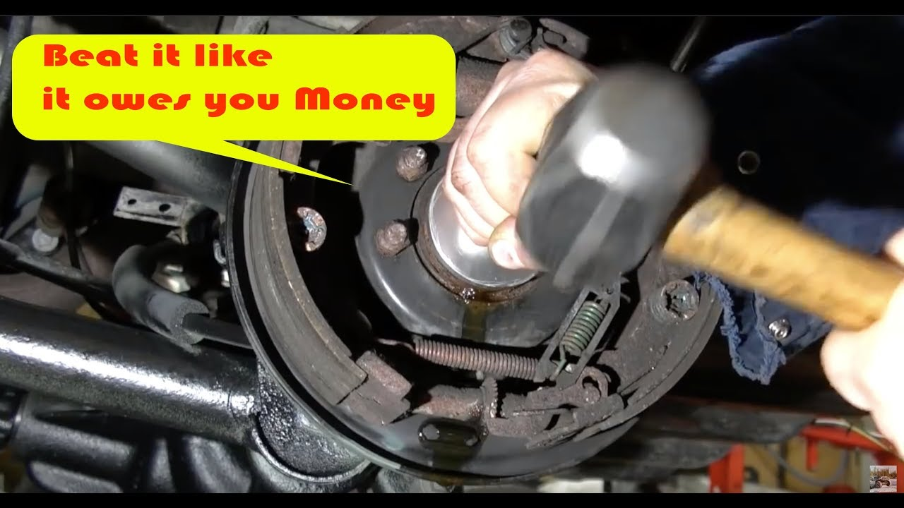 how to replace your axle seal and bearings diy [ 1280 x 720 Pixel ]