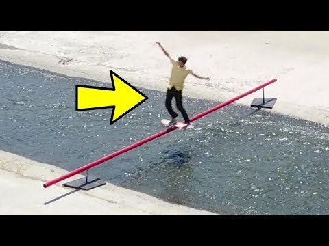 SKATING A 28 FT RAIL OVER THE LA RIVER