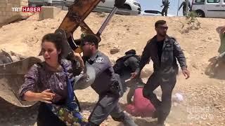 İsrail askerleri Filistinli kadının başörtüsünü yırtarak yerde sürükledi