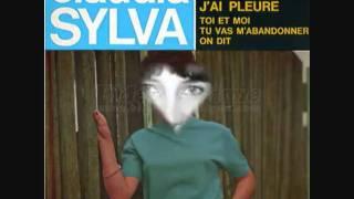 CLAUDIA SYLVA j