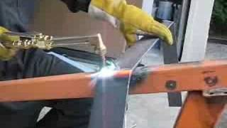 Matt bending steel flat bar with the torch