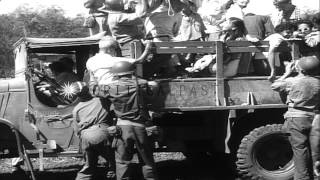 11 Airborne Division soldiers rescue Allied prisoners in Luzon, Philippines HD Stock Footage