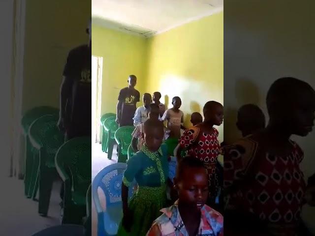 Brother Haron Leading Children in Worship 4 1 2018 GMFC WFF Western Kenya