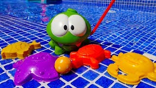 Om Nom in the pool. Funny video for kids with toys.