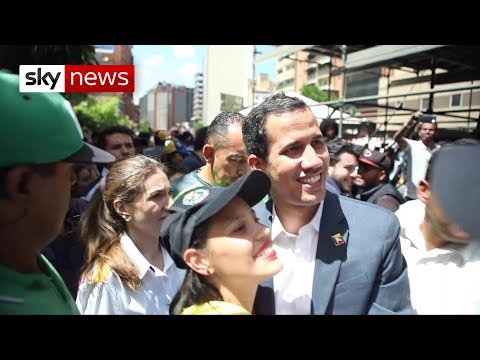 Juan Guaido joins Venezuelan protesters to demand US aid be allowed into country