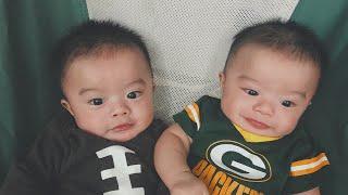 Cute fraternal twin baby boy nephews talking to each other.