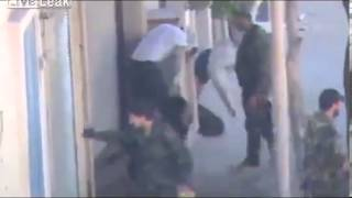 Shabiha beats civilians and captures them
