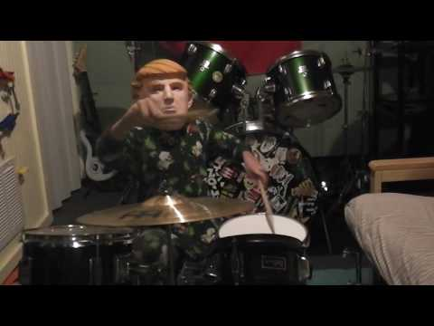 Trump drums in size 6 footie pajamas on a mini drumset