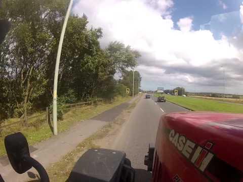 unloading combine and hauling grain