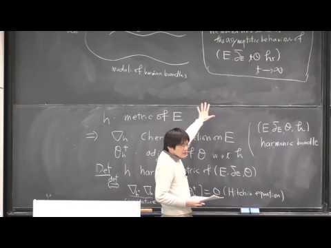 Asymptotic behaviour of certain families of harmonic bundles on Riemann surfaces