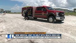 Firefighters using pickup truck to get to beach emergencies