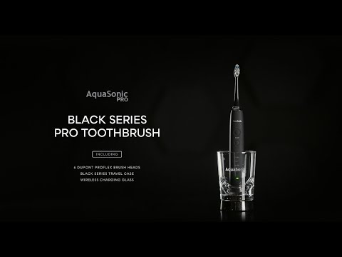 Aquasonic PRO Toothbrush with 6 ProFlex Brush Heads, Wireless Charging Glass & Case | The Daily Beast Shop