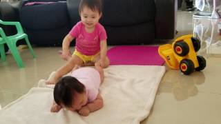Tummy time with baby 2 months old - having fun with sisters