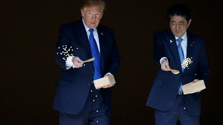 Japan rolls out red carpet for Trump amid trade war threat