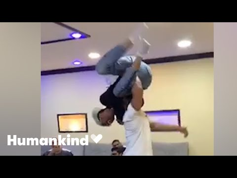 Friends wrap man in bear hug in this epic reunion | Humankind
