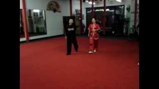 Sayaka Pereira Practicing Staff Form at Shaolin Wushu Center
