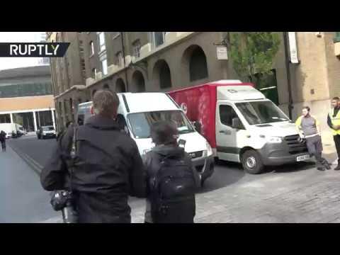 Moment Assange arrives at London court ahead of bail violation sentencing