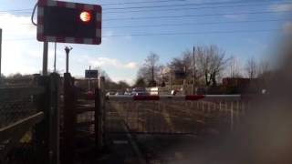 Class 91 East coast passing Offord level crossing ECML