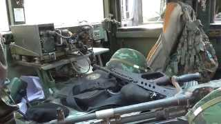 thai soldier take a rest in a big hummer on way back from exercise