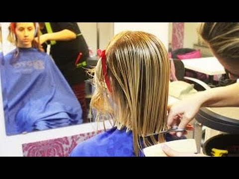 Long haired blonde woman getting a sexy bob haircut for holidays