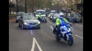 Prime Minister Theresa May being escorted by Met Special Escort Group