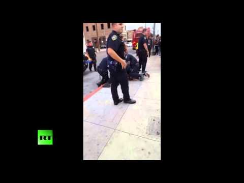 RAW: Police beat, detain teenager for jaywalking