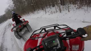 2 honda ranchers 420s out driving in the snow part one