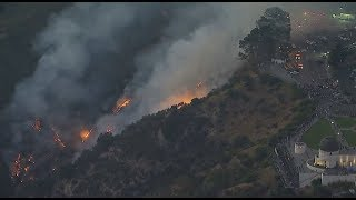 VIDEO: Crowds gather in Griffith Observatory parking lot to watch firefighters battle blaze | ABC7