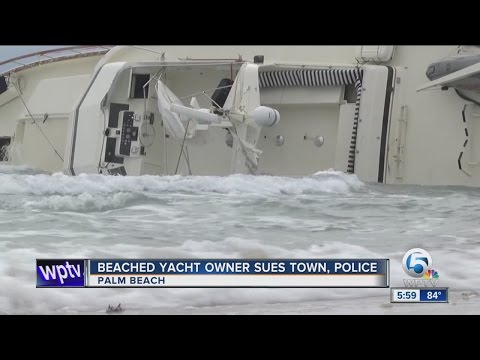 Beached yacht owner sues town, police