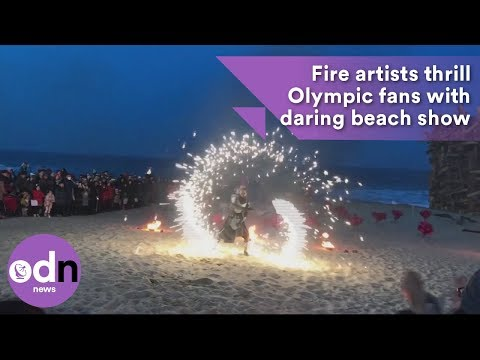 Fire artists thrill Olympic fans with daring beach show