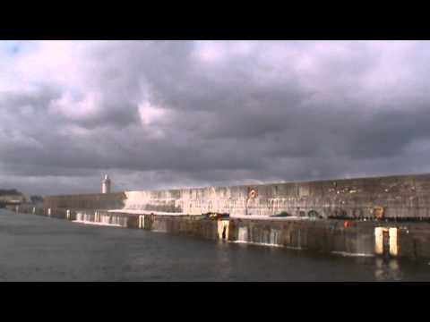 Waves crash over Buckie harbour