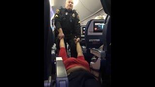 بالفيديو.. الأمن الأمريكي يسحل سيدة داخل طائرة بطريقة صادمة