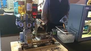 DMC DrinkBot - Robotic Bartender Mixes a Drink