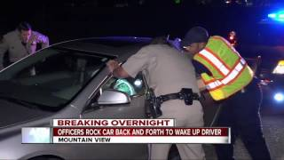 CHP officers shake car to wake up passed-out driver