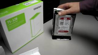 Putting together the QNAP TS-128 network storage device