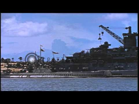 A US submarine arrives along the side of a tender in the Pacific Theater. HD Stock Footage