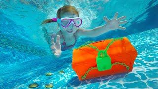 LOCKED TREASURE CHEST!! Adley swims deep to find a hidden mystery safe!  (what's inside)