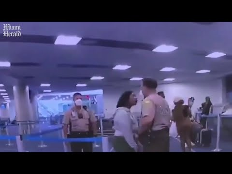 Police officer strikes woman during dispute at Miami airport