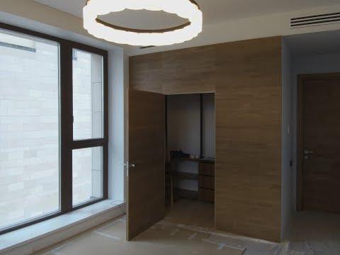 Стеновые панели со скрытой дверью.