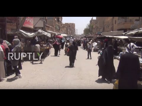 Syria: Locals optimistic as the SAA resist IS' siege of Deir ez-Zor *EXCLUSIVE*