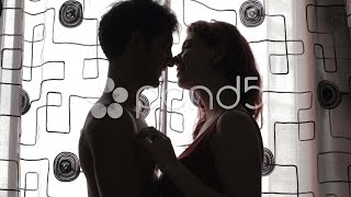 kiss - Sex - Couple hugging in front of window - lover  - silouette. Stock Footage