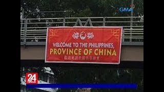 "Tarpaulin na may nakasulat na ""Welcome to the Philippines, Province of China,"" bumalandra"